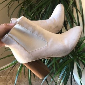 Off white boots with a 4 inch heel